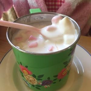 Bright green mug with hot choc and marshmallows
