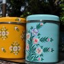 Handpainted enamelware Storage Jars in Tangerine White Posy and Duck Egg Iris designs by Jasmine White