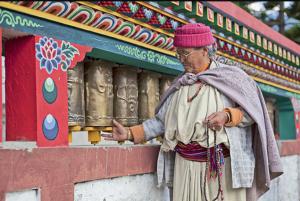 Devotee spinning prayer wheels