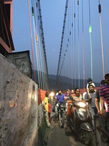 The narrow Lakshman Jhoola bridge on Ganges © Jasmine White London