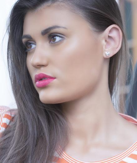 Jasmine White London Sterling silver heart shaped ear studs.